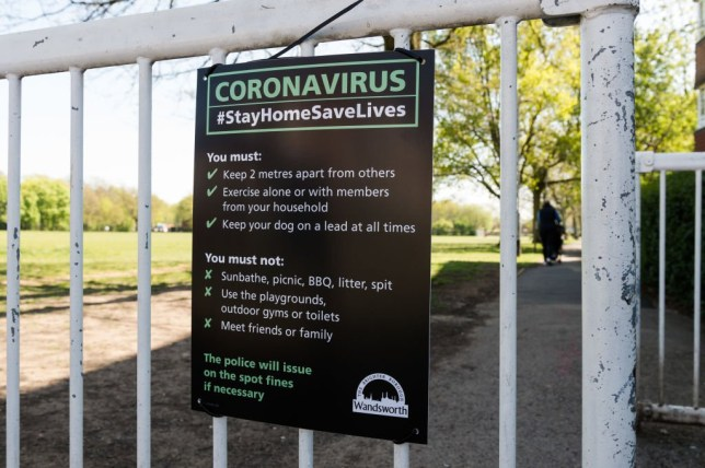 LONDON, UNITED KINGDOM - APRIL 14, 2020: A sign notifying of the social distancing rules is displayed at the gate of a park in south-west London as the UK's nationwide lockdown to slow down the spread of the Coronavirus disease enters its fourth week on 14 April, 2020 in London, England. The UK Government is due to undertake a review of the lockdown measures this week as the hospital Covid-19 death toll rose above 11,000 while 88,621 people have tested positive for the virus. (Photo by WIktor Szymanowicz/NurPhoto via Getty Images)