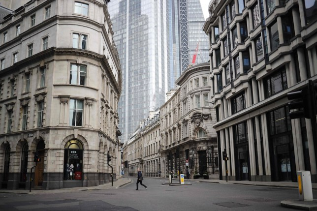 A pedestrian walks the near-deserted streets of London