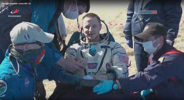 epa08368028 A handout still image taken from a video footage made available on the official website of the Russian State Space Corporation ROSCOSMOS, shows Expedition 62 NASA astronaut Andrew Morgan (C) shortly after the Soyuz MS-15 spacecraft descent module safely landed in steppe about 147 km eastwards from the city of Zhezkazgan, Kazakhstan, 17 April 2020. Expedition 62 completed their mission at the International Space Station (ISS) and returned to Earth on the Soyuz MS-15 spacecraft, which safely landed in the Kazakh steppe. EPA/ROSCOSMOS / HANDOUT BEST QUALITY AVAILABLE HANDOUT EDITORIAL USE ONLY/NO SALES