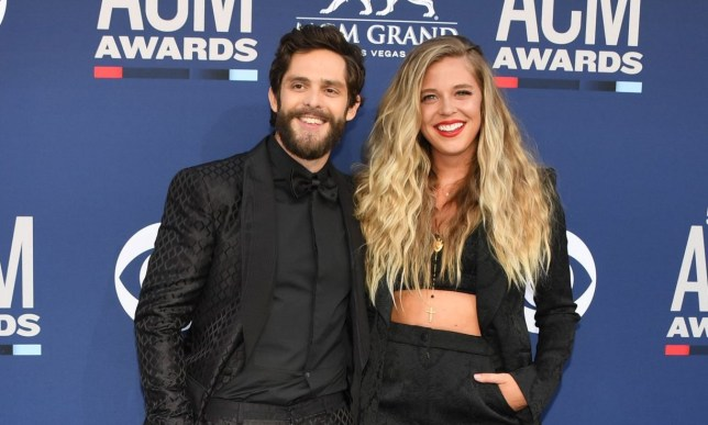 US singer Thomas Rhett (L) and his wife Lauren Akins arrive for the 54th Academy of Country Music Awards on April 7, 2019, at the MGM Grand Garden Arena in Las Vegas, Nevada. (Photo by Robyn Beck / AFP) (Photo credit should read ROBYN BECK/AFP via Getty Images)