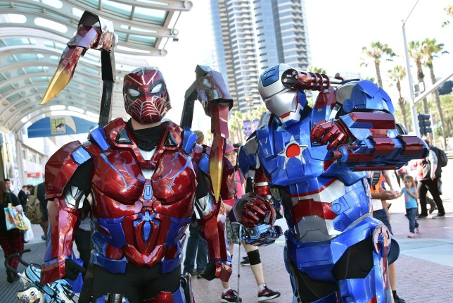 TOPSHOT - Cosplayers dressed as Transformers walk around San Diego, California, during Comic Con on July 19, 2019. (Photo by Chris Delmas / AFP) (Photo by CHRIS DELMAS/AFP via Getty Images)