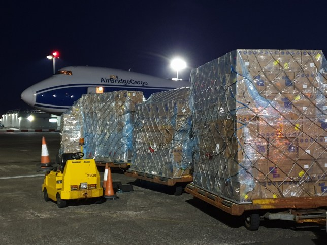 Deliveries of PPE equipment into Prestwick Airport this morning. Boxes of masks being taken off the plane for onward distribution Pics supplied by NHS National Services Scotland