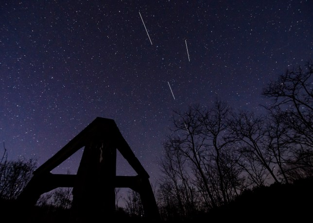 A computer-generated image from several long-exposure images shows Starlink satellites in the sky above the concrete base of a former heating plant in Salgotarjan, Hungary (Credits: EPA)
