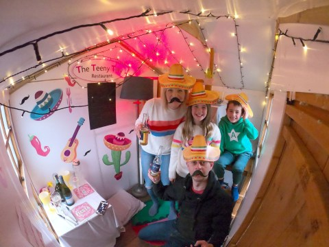 Parents turn children's playhouse into mini restaurant so the family can go out for dinner every Saturday in lockdown