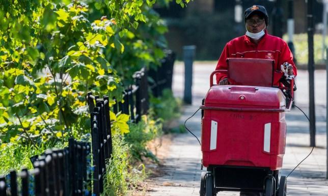 Postman delivering stock image