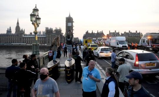 People applauding for key workers on Westminster Bridge