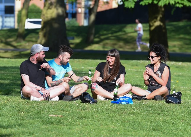 Image ??Licensed to i-Images Picture Agency. 23/04/2020. London, United Kingdom. Coronavirus crisis. Four people are seen enjoying the sunshine at Southwark Park this afternoon, as the coronavirus lockdown continues. Picture by Gustavo Valiente / i-Images