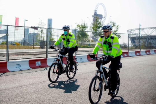 Police officers patrol in Queen Elizabeth Olympic Park in east London on April 24, 2020 during the national lockdown