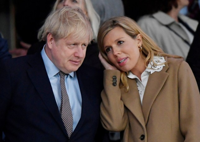 FILE PHOTO: Rugby Union - Six Nations Championship - England v Wales - Twickenham Stadium, London, Britain - March 7, 2020 Britain's Prime Minister Boris Johnson with his partner Carrie Symonds after the match REUTERS/Toby Melville/File Photo