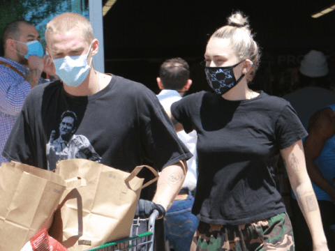 Miley Cyrus emerges from lockdown in face mask with Cody Simpson but keeps self-cut hair tied up