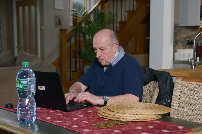 Geoff checks his laptop in Coronation Street
