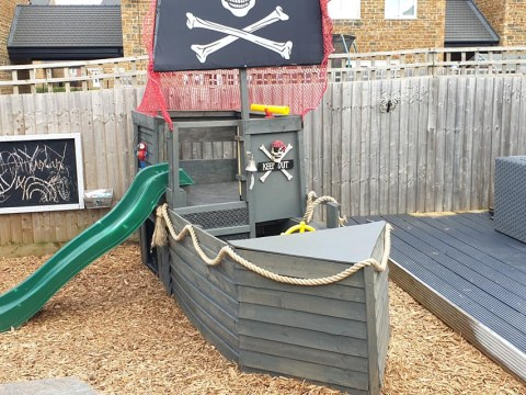 Couple builds incredible pirate ship climbing frame from pallets for £25