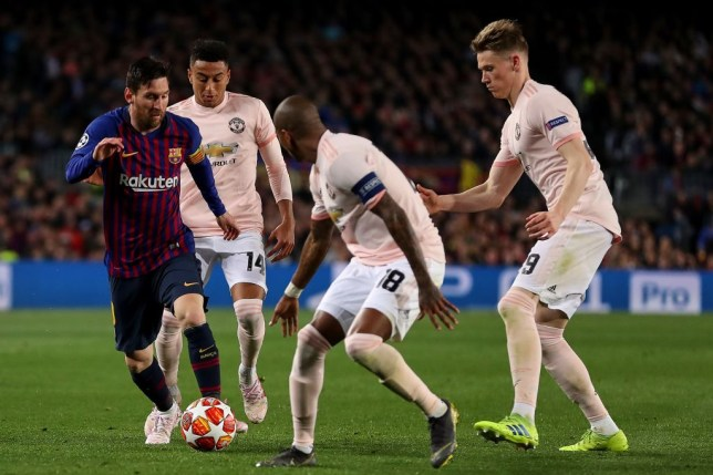 Lionel Messi is tracked by several Manchester United players
