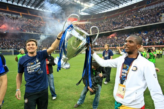 Samuel Eto'o holds the Champions League trophy after winning it with Jose Mourinho's Inter Milan