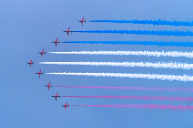 The Red Arrows performing a flypast.