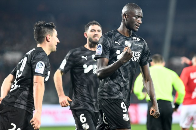 Amiens' forward Serhou Guirassy (R) celebrates after scoring a goal during the French L1 football match between Stade Brestois 29 and Amiens SC at the Francis Le Ble stadium in Brest, western France on January 25, 2020. (Photo by Fred TANNEAU / AFP) (Photo by FRED TANNEAU/AFP via Getty Images)
