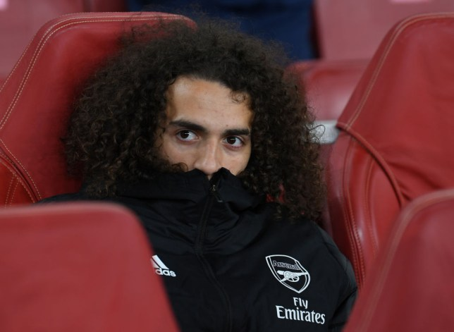 Matteo Guendouzi looks on from the bench during Arsenal's Europa League clash with Olympiacos