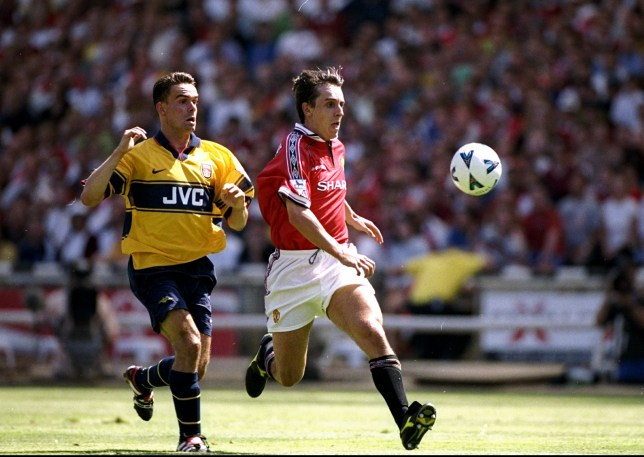 Gary Neville and Marc Overmars in action for Manchester United and Arsenal