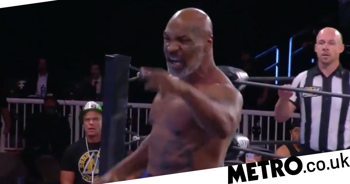 Mike Tyson looking ripped as he confronts Jake 'The Snake' Roberts in AEW appearance - Metro.co.uk