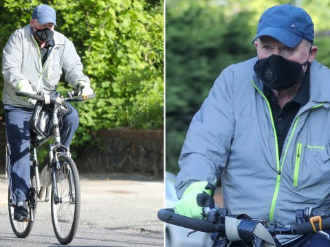 Nothing to see, just a masked Phil Mitchell going cycling