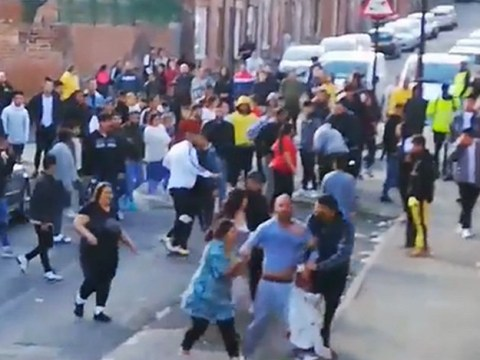 Moment 50 neighbours crowd round to watch fight erupt on street