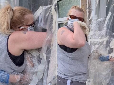 Mum makes coronavirus 'cuddle curtain' so she can hug self-isolating daughter