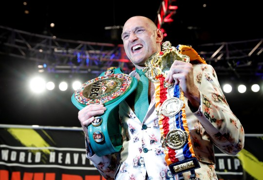 Boxing - Deontay Wilder v Tyson Fury - WBC Heavyweight Title - The Grand Garden Arena at MGM Grand, Las Vegas, United States - February 22, 2020 Tyson Fury poses with his belts during a press conference after the fight REUTERS/Steve Marcus TPX IMAGES OF THE DAY
