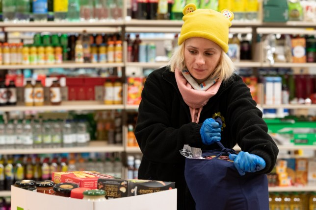 CARDIFF, WALES - APRIL 03: Claudia Apopii prepares a food parcel on April 3, 2020 in Cardiff, Wales. Staff and volunteers at Cardiff Council are helping to provide emergency food parcels to those struggling financially or for those self isolating with no family or support during the COVID-19 outbreak. The coronavirus pandemic has spread to many countries across the world, claiming over 55,000 lives and infecting over 1 million people. (Photo by Matthew Horwood/Getty Images)