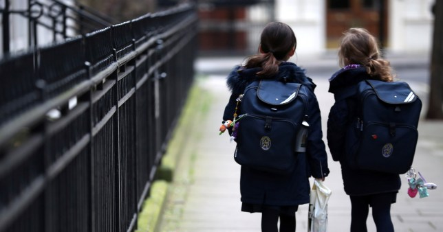Children leave school in Westminster as the majority of schools in the UK close while the spread of the coronavirus disease (COVID-19) continues. In Westminster, London, Britain March 20, 2020. REUTERS/Hannah McKay