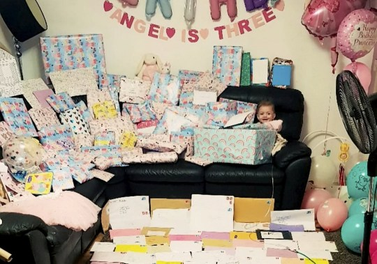 Angel-Louise Lemar (right) with all her cards and gifts. See SWNS story SWTPbday. An adoring mum asked strangers on social media to send her daughter birthday cards - now she?s got more than 250. Mum-of-five Roxie Lemar had four premature births, each arriving earlier - her youngest, Angel-Louise Lemar, was born at 26 weeks, weighing just 538 grams. Now the happy three-year-old lives with complex needs - all her feeding is done via a tube, and she is entirely oxygen dependent. Each year, the family treat her birthday as a celebration, and despite lockdown, Roxie wanted it to be no different. She reached out on Facebook, asking strangers to send her daughter birthday cards - but she didn?t expect to receive more than 250.