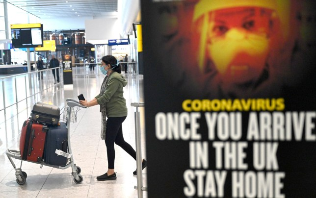 Passengers wear masks as they arrive at Heathrow Airport, in Britain  There are currently no quarantine rules or other restrictions in place for arrivals into the UK.