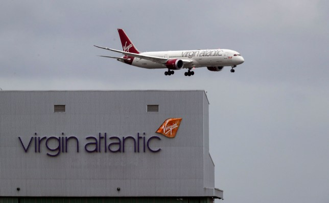 File photo dated 10/03/20 of a Virgin Atlantic plane coming in to land at Heathrow Airport as the airline has announced plans to cut 3,150 jobs. PA Photo. Issue date: Tuesday May 5, 2020. See PA story HEALTH Coronavirus. Photo credit should read: Steve Parsons/PA Wire