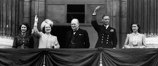 Prime Minister Winston Churchill appears on the balcony at Buckingham Palace together with King George VI and Queen Elizabeth and the two princesses on the afternoon of V-E Day, May 8, 1945. (Photo by ?? CORBIS/Corbis via Getty Images)
