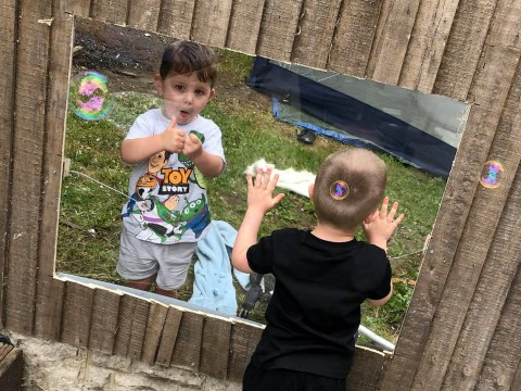 Best friends can play together in lockdown thanks to mum adding a Perspex window to the garden fence