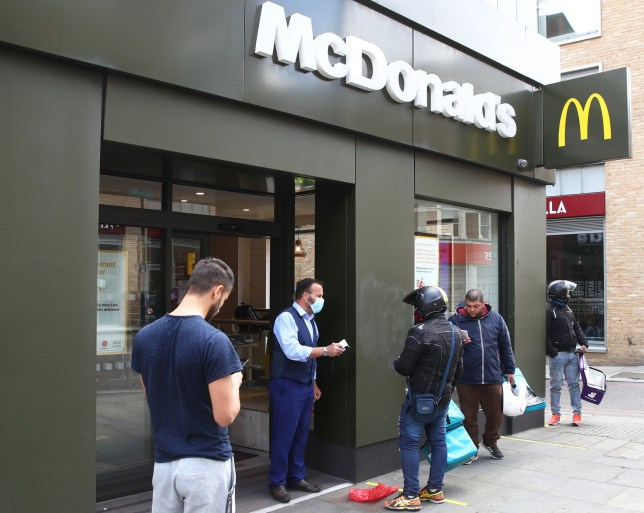 LONDON, ENGLAND - MAY 13: Delivery drivers line up outside the reopened McDonalds in Dalston on May 13, 2020 in London, England. The prime minister announced the general contours of a phased exit from the current lockdown, adopted nearly two months ago in an effort curb the spread of Covid-19. (Photo by Julian Finney/Getty Images)