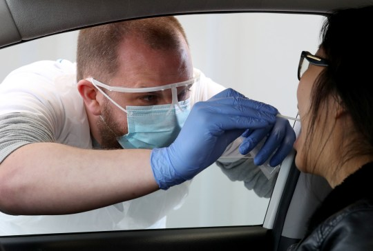 Inseo Yun is tested at a drive through testing facility for COVID-19 at Edinburgh Airport after the introduction of measures to bring the country out of lockdown. PA Photo. Picture date: Friday May 15, 2020. See PA story HEALTH Coronavirus. Photo credit should read: Andrew Milligan/PA Wire