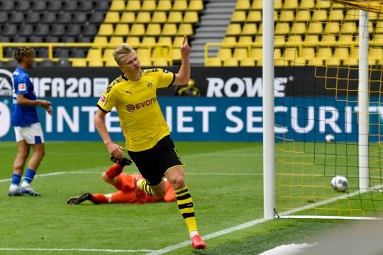 Dortmund's Erling Haaland celebrates after scoring the opening goal during the German Bundesliga football match between Borussia Dortmund and Schalke