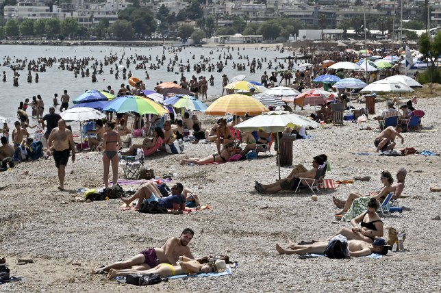 Beachgoers enjoy the sun and sea at public beach during the official reopening of beaches to the public on May 16, 2020 in Varkiza, Greece. Greece allowed the reopening of organised beaches after easing of measures against the spread of the coronavirus disease (COVID-19)with strict social distancing measures that would affect private beaches all over Greece, where shade umbrellas must be planted at least 4 meters (13 feet) apart, and a maximum 40 Beachgoers will be allowed in every 1,000 square meters (11,000 square feet) of beach.