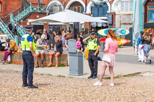 ? Licensed to London News Pictures. 16/05/2020. Brighton, UK. Members of the public take to the beach and promenade in Brighton and Hove as the lock down is relaxed across the UK. Photo credit: Hugo Michiels/LNP