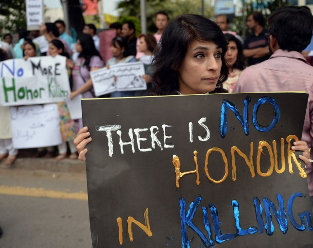 Pakistani human rights activists hold placards during a protest in Islamabad, Pakistan