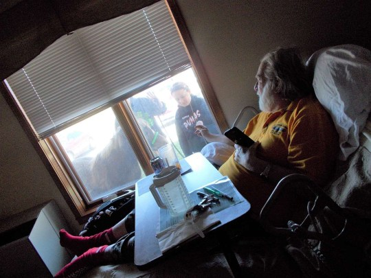 11-year-old Jorja Boller visits an old man in a care home, along with her horse, standing outside the window
