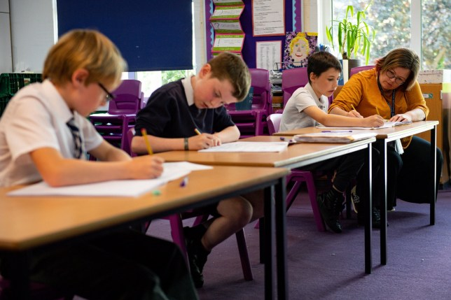 Children of essential workers socially distance whilst in lesson at Kempsey Primary School in Worcester