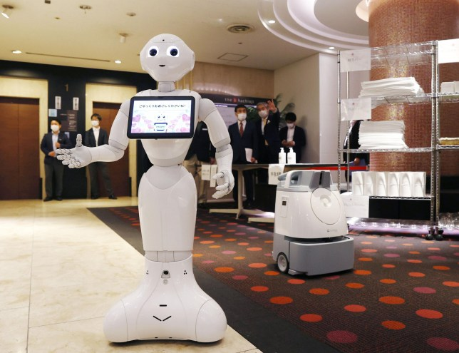 Humanoid robot Pepper is placed on April 30, 2020, at the lobby area of a hotel in Tokyo reserved for coronavirus patients with mild or no symptoms. (Photo by Kyodo News via Getty Images)