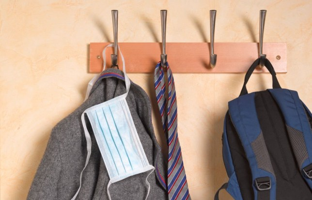 A School uniform hangs up with a face mask on May 18,2020 in London,England.