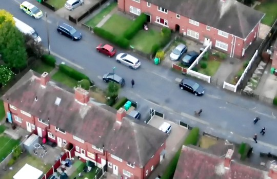 A man wanted in connection with a report of burglary was arrested yesterday after Nottinghamshire Police?s drone team followed a suspect evading officers on the ground. See SWNS story SWMDchase. Officers attended a house in Frinton Road, Aspley, at around 7pm last night as part of a hunt for a 24-year-old man wanted in connection with three reports of burglary. When police attended the address, a woman allegedly obstructed officers from moving to investigate the man?s whereabouts.It was at this point, a man fled a property on foot via the front garden. Nottinghamshire Police?s drone team supported response officers on the ground, guiding them as a man weaved through properties? gardens and hopped over fences.In the footage, officers can be seen moving to intercept a man thanks to guidance from the drone team in the sky. A man eventually stops and is safely detained by police.