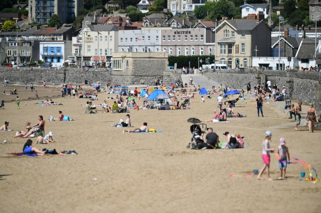Sunbathers enjoy the hot weather at Weston-super-Mare