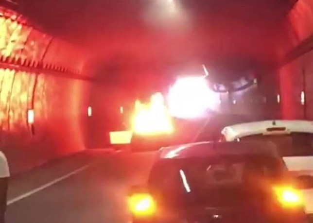 This is the terrifying moment a car exploded into flames inside a tunnel - sparking panic among motorists. Omer Alamri took the dramatic footage as people fled from vehicles using the A38 Queensway tunnel in Birmingham city centre last night [May 20]. Caption: Mobile phone still of a car which burst into flames in the 38 Queensway tunnel in Birmingham city centre on May 20, 2020