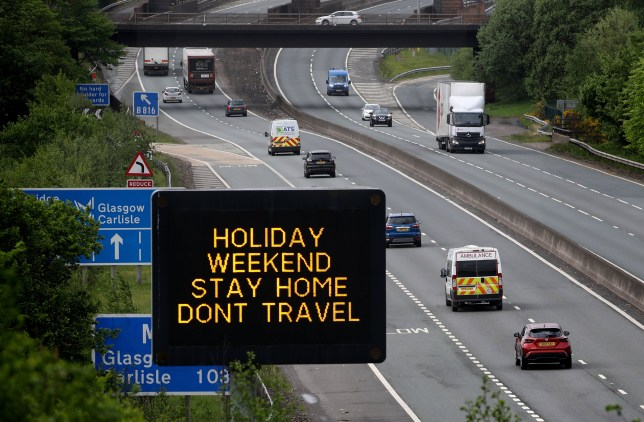 Motorway sign urging people to stay home