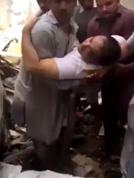 Moment passengers pulled alive from Karachi plane crash