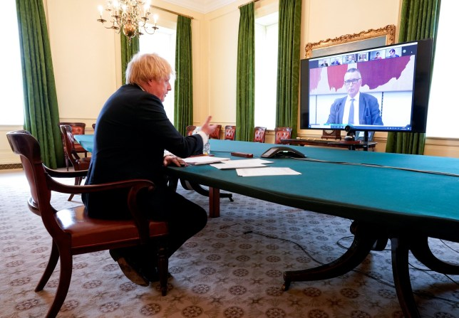 Britain's Prime Minister Boris Johnson appears before the Liaison Committee via Zoom from the cabinet room at 10 Downing Street, amid the coronavirus disease (COVID-19) outbreak, in London, Britain May 27, 2020. Andrew Parsons/10 Downing Street/Handout via REUTERS THIS IMAGE HAS BEEN SUPPLIED BY A THIRD PARTY. IMAGE CAN NOT BE USED FOR ADVERTISING OR COMMERCIAL USE. THE IMAGE CAN NOT BE ALTERED IN ANY FORM. NO RESALES. NO ARCHIVES